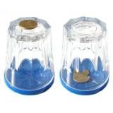 Moneda a través de un vaso